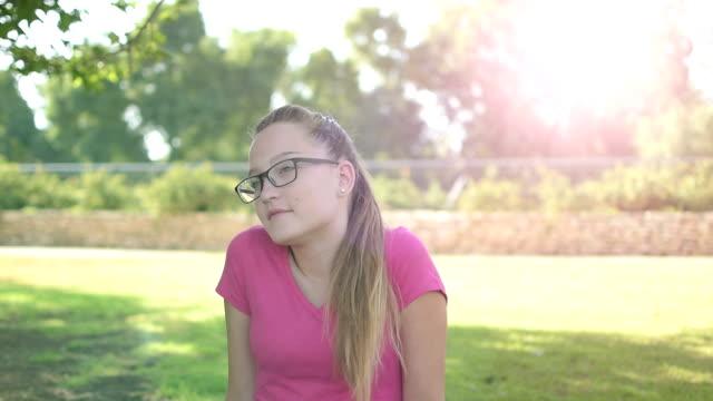 Emotional-teenager-girl-looking-at-camera-and-smiling