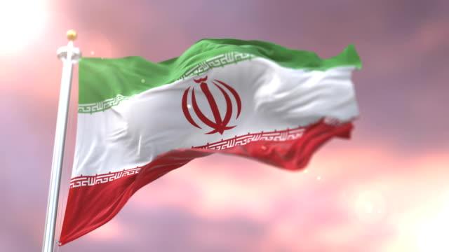 Flag-of-Iran-waving-at-wind-in-slow-at-sunset-loop