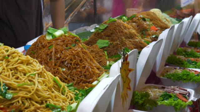 famous-night-phuket-island-patong-street-food-market-corner-slow-motion-panorama-4k-thailand