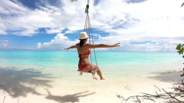 Girl-Swinging-on-a-Swing-on-Maldives