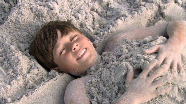 Boy-buried-in-sand