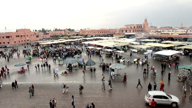 People-strolling-around-the-booths-and-stalls-in-Jemma-Dar-Fna-Marrakech-Morocco