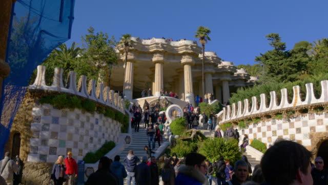 gaudi-park-guell-sunny-day-crowded-main-entrance-4k-barcelona-spain