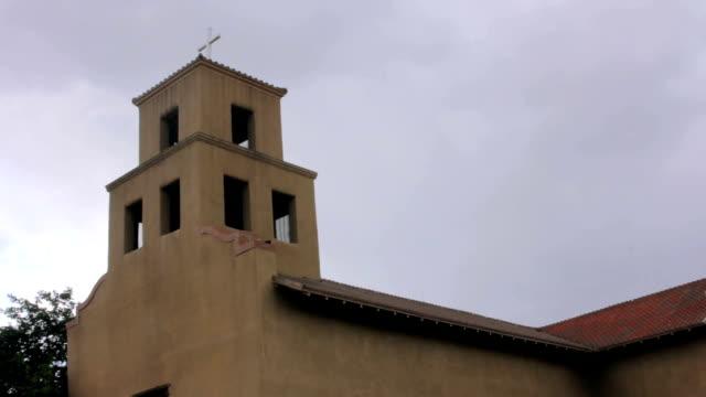 Storm-Clouds-Gather-Behind-an-Historic-Adobe-Catholic-Church