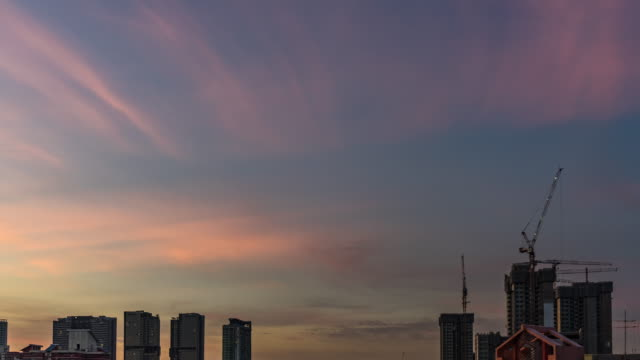 Sunset-view-of-the-Downtown-Singapore-skyline-from-dusk-to-night-with-clouds-moving