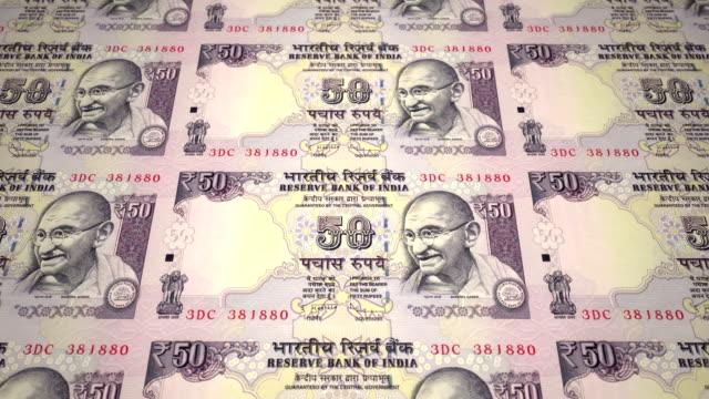 Banknoten-von-fünfzig-indische-Rupien-Indiens-Rollen-Bargeld-Schleife