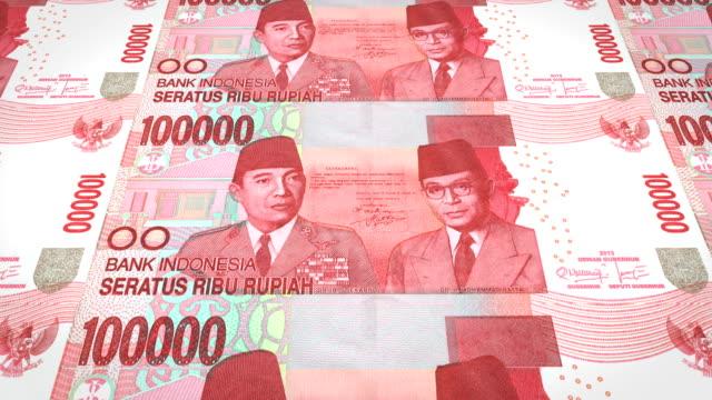 Banknoten-der-hunderttausend-indonesische-Rupiah-Rollen-Bargeld-Schleife
