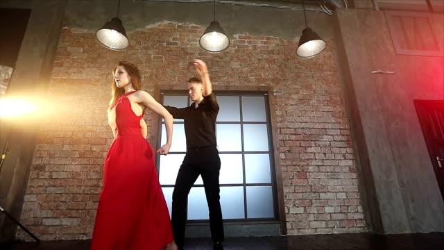 Professional-dancers-dancing-tango-in-ballroom-
