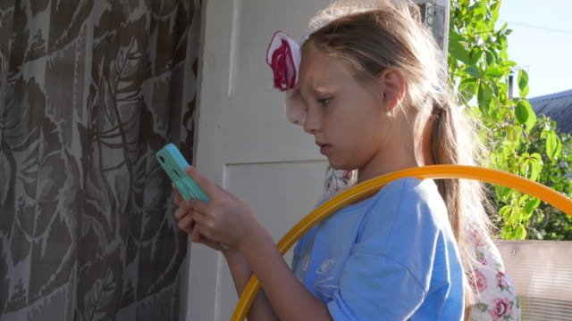 Happy-teenager-girl-using-mobile-phone-for-funny-communication-with-fiends