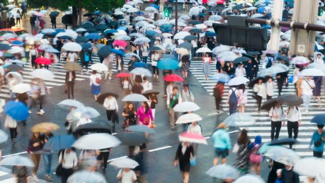 Shibuya-district-at-rainy-day-with-crowd-passing-crosswalk-Tokyo-Japan-4K-Timelapse-