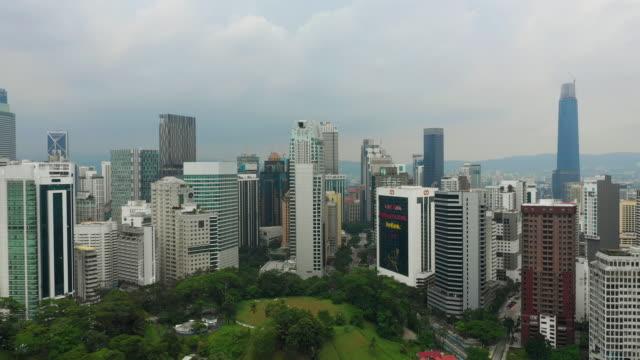 noche-tiempo-kuala-lumpur-famoso-parque-céntrico-más-alta-construcción-aérea-Malasia-panorama-4k