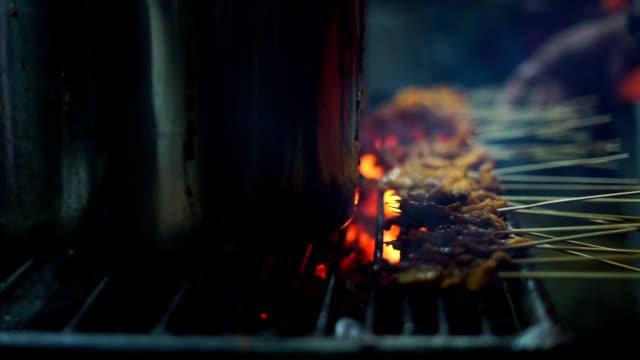 Street-food-vendor-prepares-grill-Satay-Padang-at-night-market