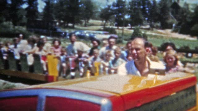 DENVER-COLORADO-1951:-Family-riding-Elitch-Gardens-classic-train-ride