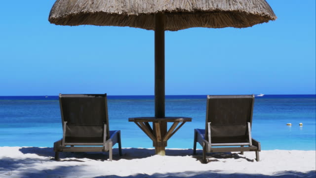4K-Perfect-holiday-postcard---ocean-view-with-2-deckchairs