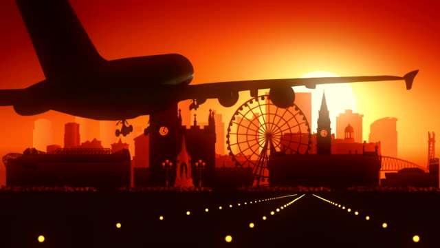 Manchester-Airplane-Landing-Golden-Sunset