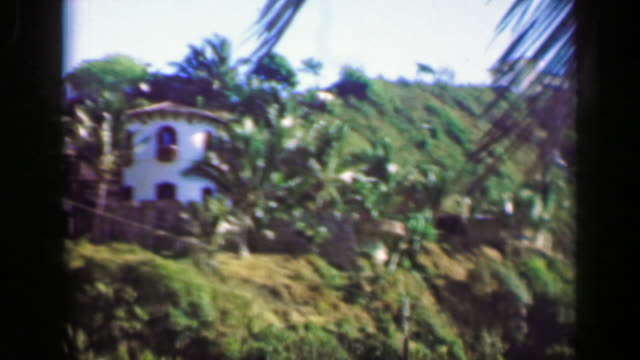 1952:-Wealthy-villa-houses-in-tropical-setting-mountain-cliff-overlooks-