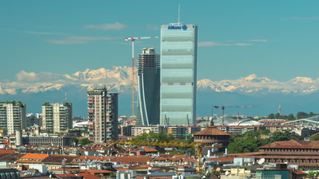 italy-day-milan-city-downtown-construction-rooftop-mountains-panorama-4k-time-lapse