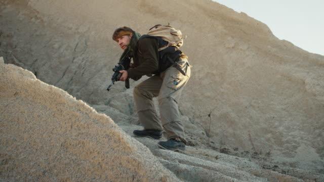 Armed-Terrorist-Walking-in-Desert-Environment