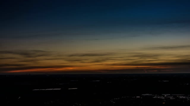 Timelapse-of-Milan-city-area-and-Po-Valley-Italy-at-sunrise-Aerial-View