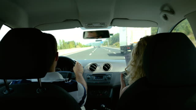 A-couple-driving-in-a-car-on-a-vacation-time-lapse