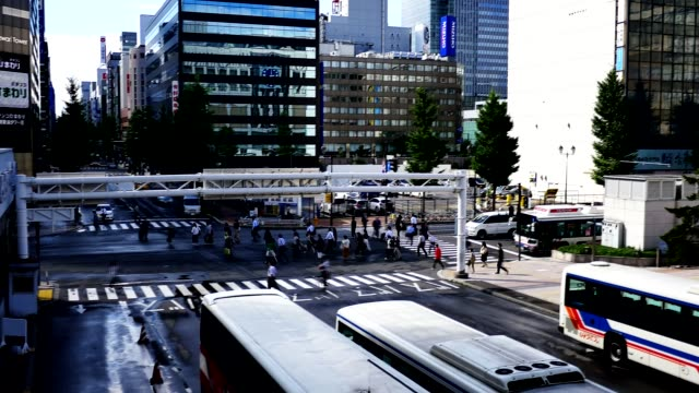 Wide-shot-of-people-walking-at-a-busy-cross-road-junction