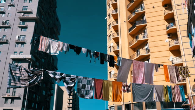 Clothes-hanging-and-drying-on-a-rope-on-a-multi-story-building-in-a-poor-district-of-the-city
