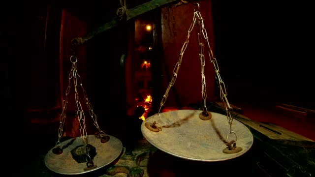 Antique-balance-with-weight-in-scale-on-bacground-funeral-pyre-and-river-Ganga-night-time