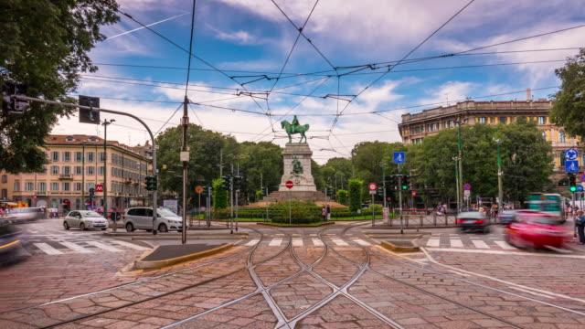 italy-milan-city-summer-day-traffic-largo-cairoli-square-panorama-4k-time-lapse