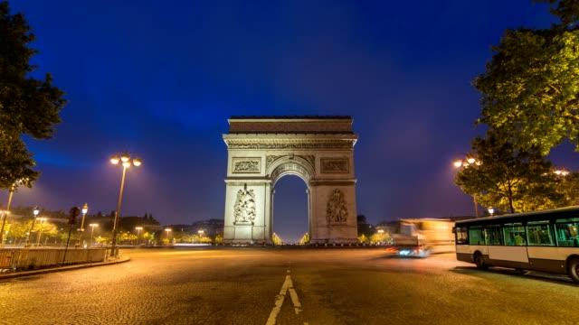 Paris-city-skyline-night-to-day-timelapse-at-Arc-de-Triomphe-and-Champs-Elysees-Paris-France-4K-Time-lapse
