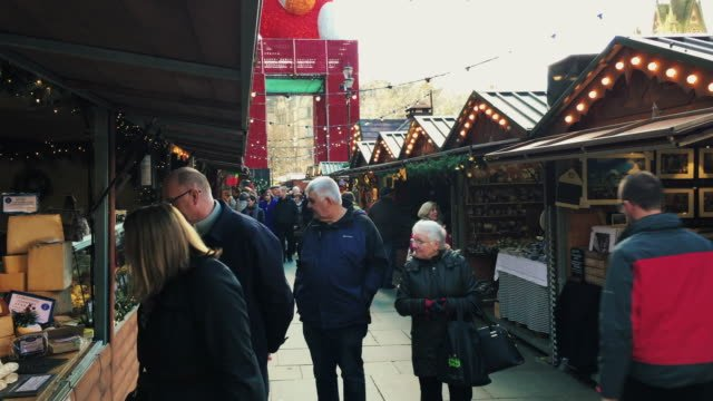 MANCHESTER-UK---DECEMBER-16-2016-Shot-of-shoppers-at-the-Christmas-market-in-front-of-the-Manchester-Town-Hall-on-Albert-Square-December-16-2016