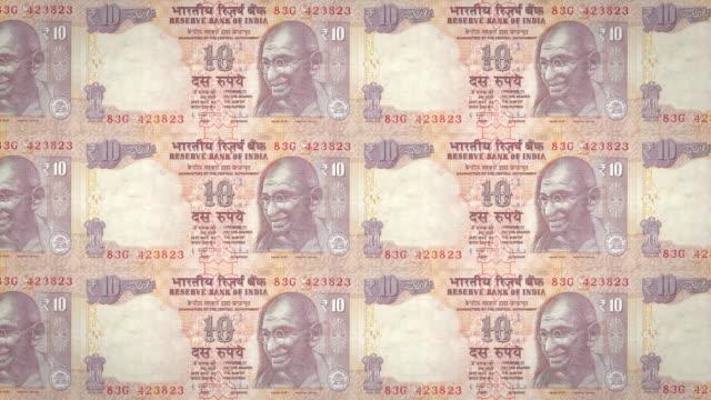 Banknoten-der-zehn-indischen-Rupien-Indiens-Rollen-Bargeld-Schleife