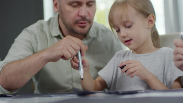Girl-Drawing-with-Daddy-at-Home