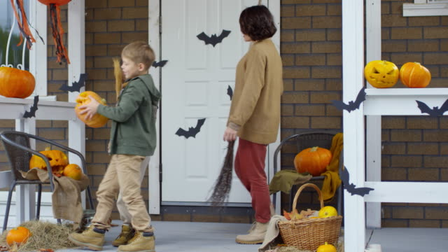 Family-Decorating-Porch-for-Halloween-Celebration