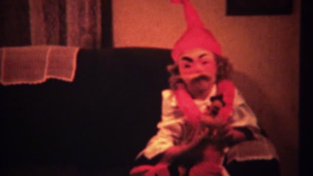 1940:-Creepy-Halloween-costume-on-cute-girl-takes-off-mask-