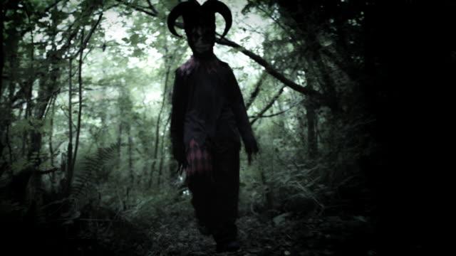 4k-Halloween-Shot-of-a-Child-in-Joker-Costume-Following-the-Camera