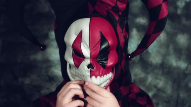 4k-Halloween-Shot-of-a-Child-in-Joker-Costume-Taking-it-Off