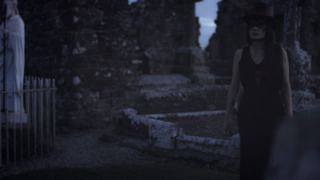 4k-Halloween-Shot-of-a-Witch-Walking-in-the-Cemetery