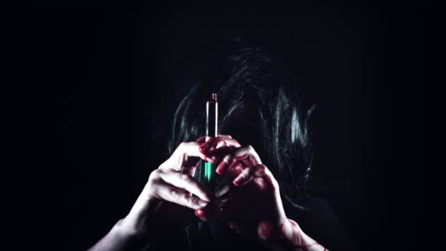 4K-Horror-Creepy-Woman-Holding-Injection-with-Blood