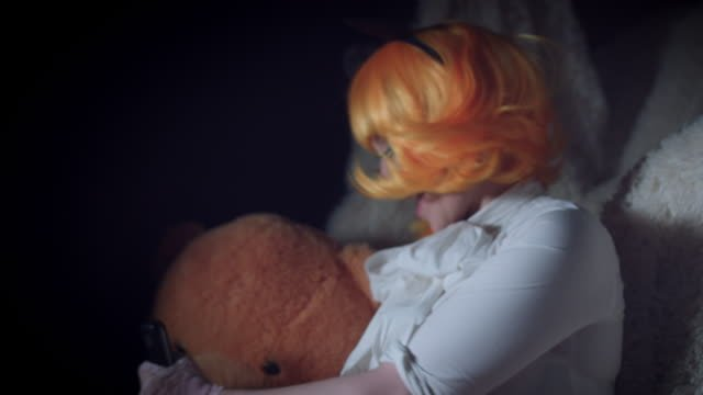 4K-Halloween-Shot-of-Doll-Woman-Stabbing-her-Toy-with-Knife