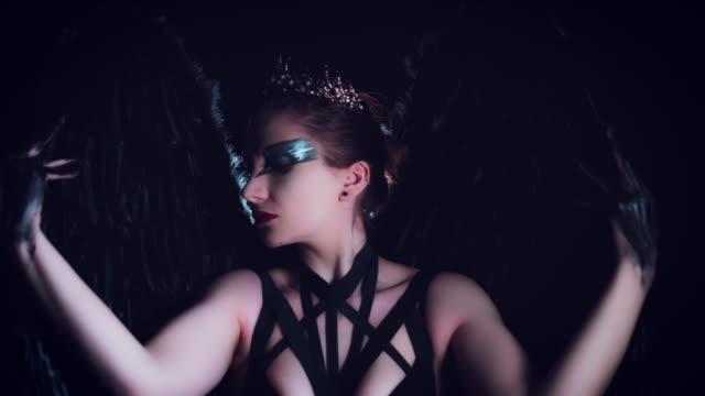 4K-Halloween-Horror-Woman-Posing-with-Black-Wings