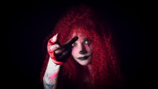 4k-Halloween-Horror-Clown-Woman-Gesturing-with-Hand