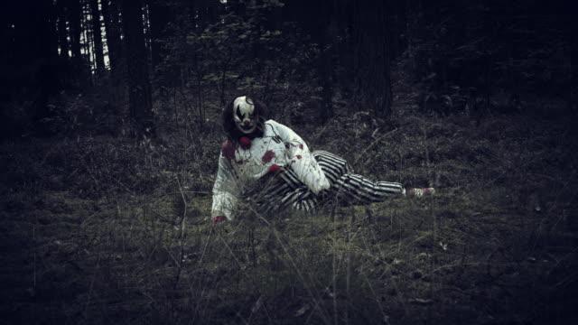 4K-Halloween-Horror-Clown-in-Forest-Waking-Up