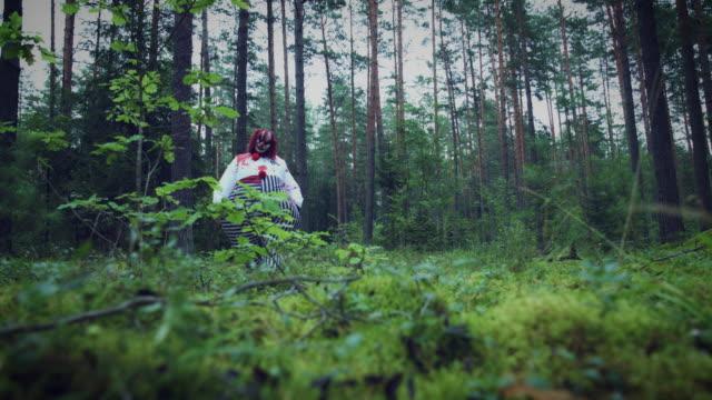 4K-Halloween-Horror-Clown-in-Forest-Walking-to-Camera