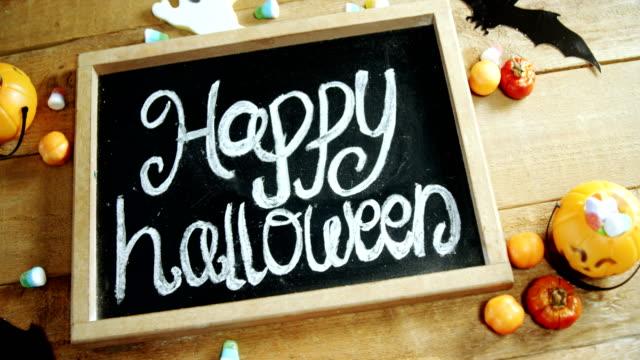 Happy-halloween-text-written-on-a-slate-4k