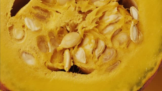 Halloween-colorful-hokkaido-pumpkin---stop-motion-animation-Healthy-vegetable-raw-food-preparing---extreme-close-up-view-