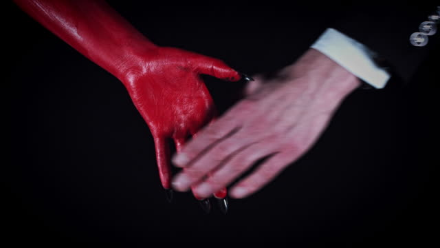 4k-Horror-Devil-Shaking-Hand-with-Business-Man