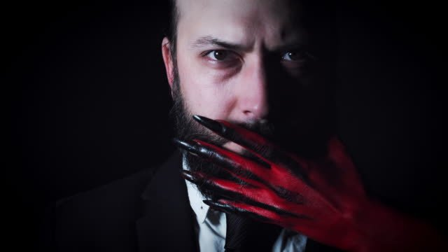 4k-Horror-Devil-s-Hand-Trying-to-Kill-Businessman