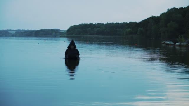 Horror-woman-soaking-in-water-river-