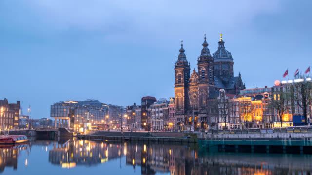 Amsterdam-Netherlands-time-lapse-4K-city-skyline-night-to-day-timelapse-at-Basilica-of-Saint-Nicholas