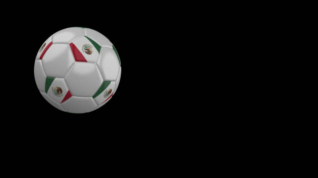 Soccer-ball-with-flag-of-Mexico-flies-past-camera-slow-motion-alpha-channel